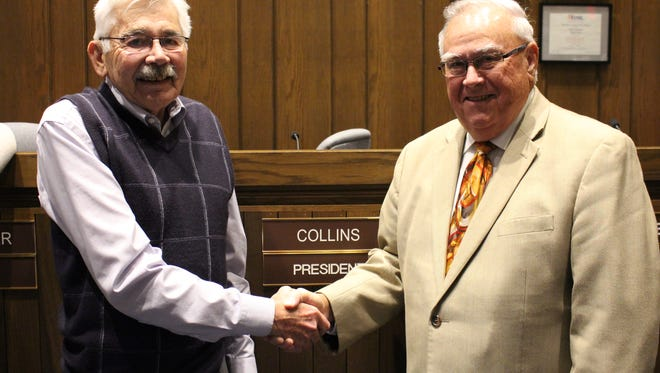 Incoming Ontario council president Jim Hellinger, left, and outgoing Ontario council president Larry Collins shake hands after the council meeting Wednesday, Dec. 20, 2017. Wednesday was Collins' last meeting as council president after four years in the position.