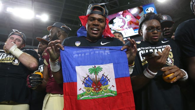 FSU's Deondre Francois celebrates with his teammates after their 33-32 win over Michigan during the Orange Bowl at the Hard Rock Stadium in Miami Gardens on Friday Dec. 30, 2016.