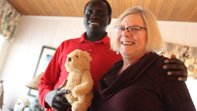 Victor Deng and Patricia Beall, holding the stuffed animal she received from the doctor when she was diagnosed with terminal cancer. She sponsored and mentored Deng when he first came to the U.S. 16 years ago as a Sudanese refugee. Since then, she's been like his mother, Deng said.