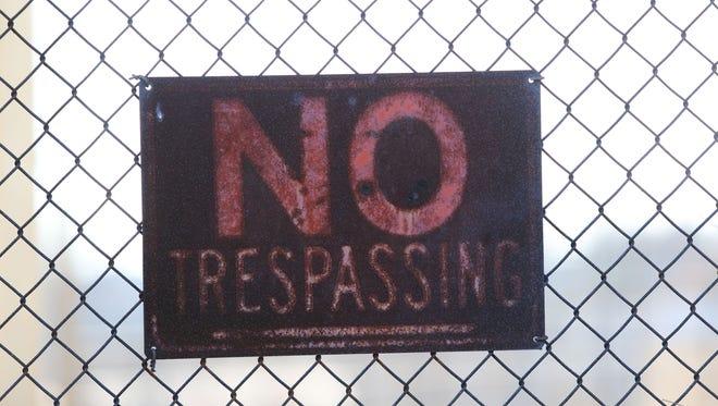 "A ""No Trespassing"" sign"