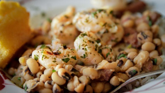 Add flavor to black-eyed peas with bacon, andouille