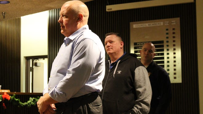 (From left to right) Mansfield police Captain Bret Snavely, Chief Ken Coontz and Assistant Chief Keith Porch stand before Mansfield City Council on Tuesday, Jan. 2, 2018. Council recognized Snavely, who will retire Jan. 5 after 34 years in law enforcement.