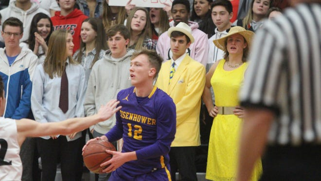 Kyle Kraninger looks to pass for New Berlin Eisenhower in front of the Pewaukee student section Jan. 5, 2018.