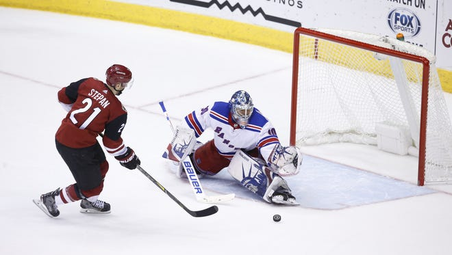 Arizona Coyotes forward Derek Stepan (21) has his shot stopped by New York Rangers goaltender Henrik Lundqvist (30) during a shootout of a NHL game at the Gila River Arena in Glendale, Az., Saturday, January 6, 2018.