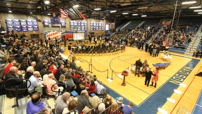 Mourners filled the lower level of bleachers inside Madison High School for the Jan. 7 memorial service of county native and Madison Early College High School teacher Adam Worley.