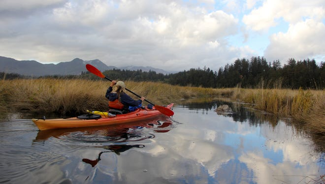 Ginnette Marberry kayaks the mudflats of the Nehalem River on the Oregon Coast.