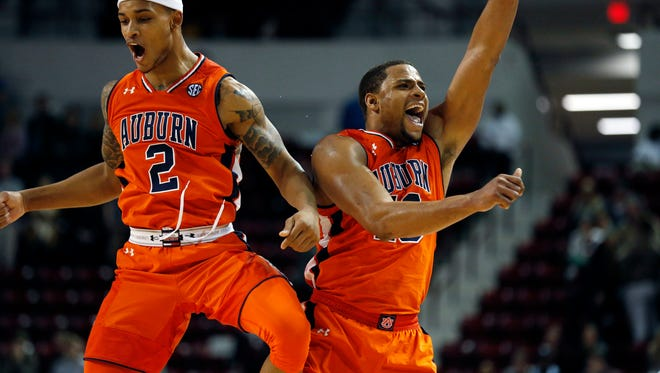 Auburn guard Bryce Brown (2) and Desean Murray (13) celebrate their 76-68 NCAA college basketball game win over Mississippi State in Starkville, Miss., Saturday, Jan. 13, 2018.
