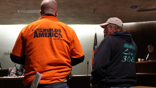 Jeff Sellers, business manager for LiUna! Local 1216, left, and Dan Mapes, president of AFSCME Local 3088, talk with Mansfield City Council on Tuesday, Jan. 16. Council voted 6-2 to strongly oppose six proposed right-to-work state constitutional amendments.