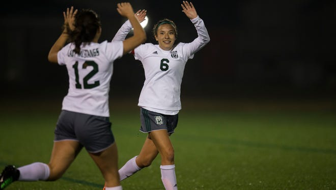 King's Isabella Strasheim celebrates a goal during their District 30-5A opener against Carroll Friday, Jan. 19, 2018 at Cabaniss Soccer Field.