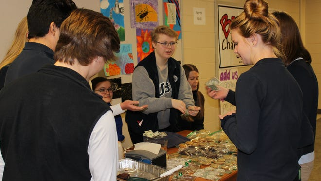 SMSA students sold baked goods during lunch for Free the Kids campaign.