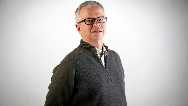 Enquirer Cincinnati Reds beat writer John Fay poses in the Enquirer Studio in downtown Cincinnati on Wednesday, Jan. 24, 2018.