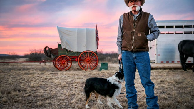 Denny Schilthuis chats with friends at camp on the first night of the Santa Fe Trail Ride and Wagon Train Friday, Jan. 26, at U Ranch north of Sterling City.