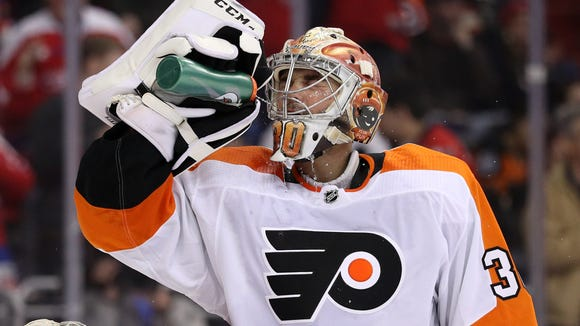Goalie Michal Neuvirth allowed five goals on 20 shots and said he felt ill after the first period, but stayed in and didn't mention it to the coach.