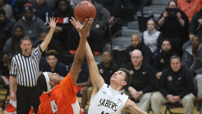 Nobal Days of Racine Park (left) and Max Alba of Franklin battle for the opening tip Jan. 30.