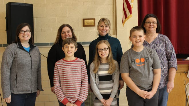 Bert Fall, first place, Kerynn Christiansen, second place, and Samuel Roberts, third place, will represent Immaculate Conception School at the county spelling bee next week.