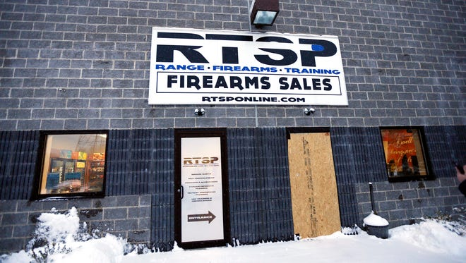 Plywood boards up the entrance at RTSP after an overnight break in at the state of the art firearms training facility in Randolph. January 12, 2018. Morristown, NJ.
