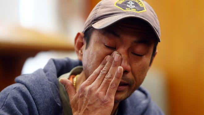 Harry Pangemanan breaks down as he tells his story of ICE officers knocking on his door this morning. Pangemanan is now claiming sanctuary at the Highland Park Reformed Church as two other Indonesian men were detained today. January 25, 2018. Highland Park, NJ.