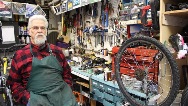 Chet Wright works in his shop on a bike that will go to Juarez via Siguiendo Los Pasos de Jesús. Wright uses frames provided by the SCSWA Recycling Center and breathes in new life with new tubes and chains.