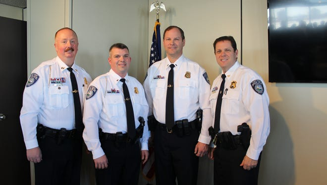 Chris Frazier and Brian Kerrigan, center, were promoted to the rank of lieutenant in the Port Huron Police Department on Monday.
