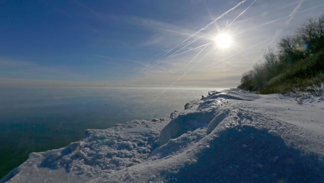 The sun beats down on a frozen shoreline off Lake Michigan at Big Bay Park in Whitefish Bay.