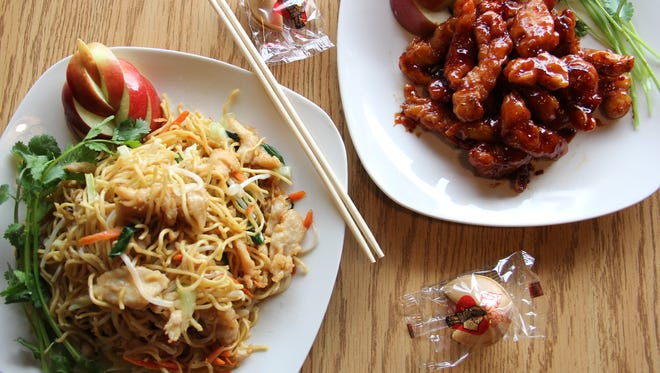 Chicken Lo Mein and General Tso's Chicken arrive with fortune cookies at Happy Jing on Portland Road