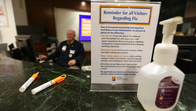 Hand sanitizer in a bottle as well as a pen on the visitors desk at Morristown Medical Center. As cases of the flu continue to rise, a number of North Jersey healthcare providers and hospitals have imposed temporary visitation restrictions. At Morristown Medical Center, signs with visitors restrictions are posted next to hand sanitizing stations for when visitors enter or exit the hospital. February 9, 2018. Morristown, NJ.