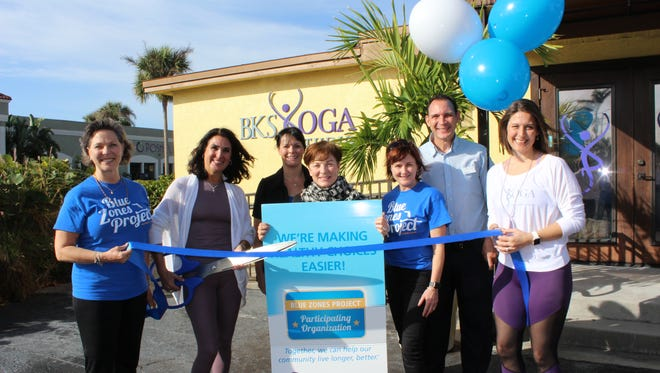 Staff at BKS Yoga Studio in Naples celebrate earning Blue Zones Project recognition.