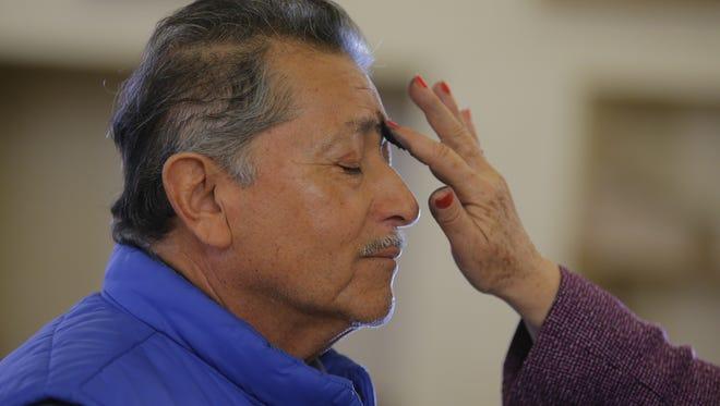 Federico Almaraz receiving ashes on Wednesday at St. Mary of the Nativity Catholic Church.
