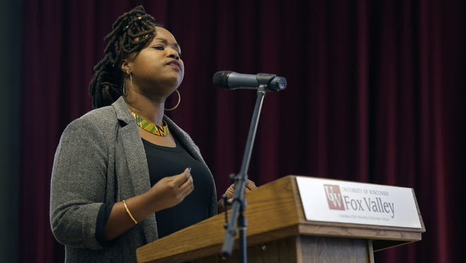 Jamila Lyiscott from the University of Massachusetts Amherst speaks Saturday during the Fox Cities annual Black History Program sponsored by African Heritage Inc. at the University of Wisconsin-Fox Valley in Menasha.