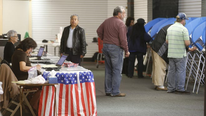 El Pasoans cast ballots Tuesday at Bassett Place as early voting begins. It runs through March 2. The primary is March 6.