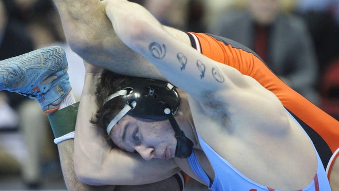 Josh Otto battles with Zach Lee of Kaukauna in the WIAA Division 1 state championship match Feb. 24, 2018. Otto won on a late escape, 3-2.