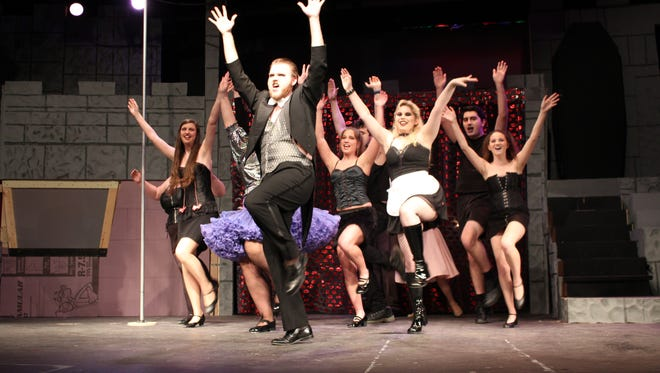 "Cast members perform during a rehearsal of The Ohio State University-Mansfield's production of ""The Rocky Horror Picture Show"" on Tuesday. The show will be performed Thursday, Friday, Saturday and Sunday in Founders Auditorium."
