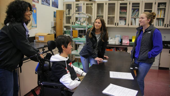 Nicholas Raines talks with Emma Horton and Julia Bell at Salinas High.