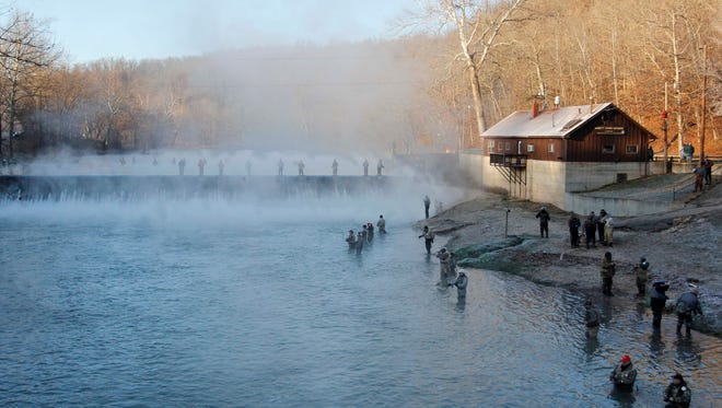 Anglers gather for opening day of trout season at Bennett Spring Park in this file photo.