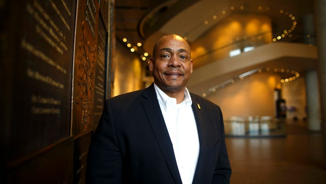 New president Dion Brown poses on the second floor of the National Underground Railroad Freedom Center in downtown Cincinnati on Wednesday, Feb. 28, 2018. Brown previously served as the founding executive director of the National Blues Museum in St. Louis.