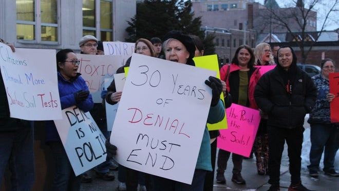 Protesters gather outside City Hall on Feb. 27 to encourage more testing on Thomas Street for toxic contaminants.