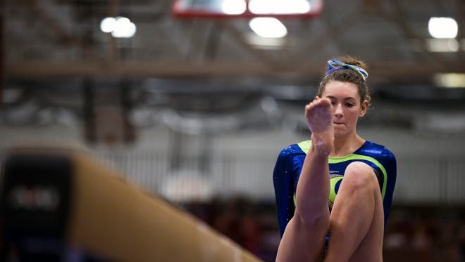 A Whitefish Bay gymnasts competes on the balance beam in the team competition of WIAA state gymnastics meet in Wisconsin Rapids, Wis., March 2, 2018.