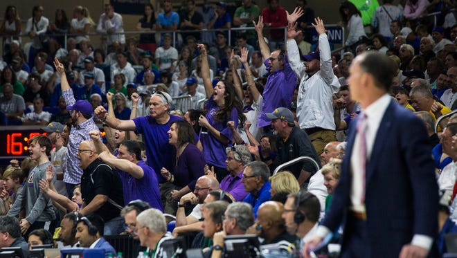 The Lipscomb fan section erupts in cheers after a Bisons basket Sunday.
