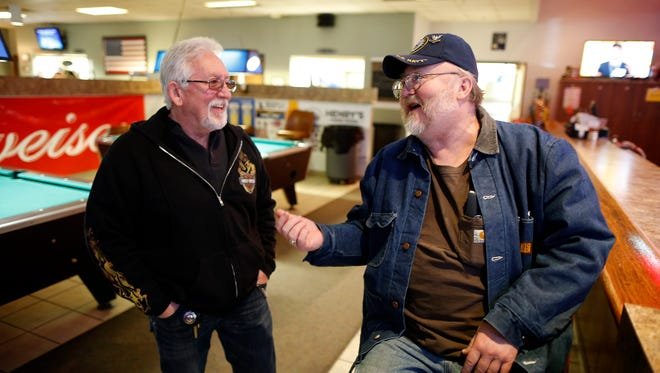Retired steelworker Sterling Perkins (right) of Middletown, talks with his friend Gary Williams, who also retired from the steel industry, at the Moose Lodge in Middletown, Ohio, on Monday, March 5, 2018.
