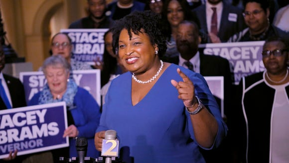 Democrat Stacey Abrams holds a news conference Tuesday