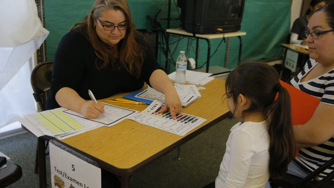 Prospective students went through evaluations Wednesday at Alisal Community School.