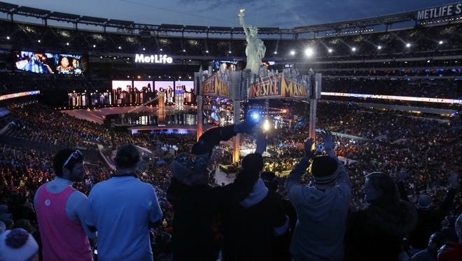 Fans watch the WWE Wrestlemania 29 wrestling event on Sunday at MetLife Stadium in East Rutherford. AP Fans watch the WWE Wrestlemania 29 wrestling event, Sunday, April 7, 2013, in East Rutherford, N.J. (AP Photo/Mel Evans)
