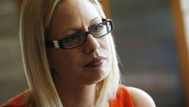 Congresswoman Kyrsten Sinema has donated $33,800 to charity to erase her ties to a controversial political donor.