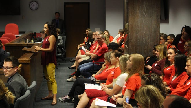 Emily O'Neil, an Arizona second grade teacher, testifies before the House Ways and Means Committee on Wednesday, voicing her opposition to SB 1467.
