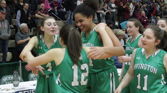 Mary Brereton (left), Heather Hall (middle), and Grace Thybulle (right) celebrate after an 81-62 win over Northeastern Clinton in the Class B state semifinals at Hudson Valley Community College. Mar. 16, 2018.