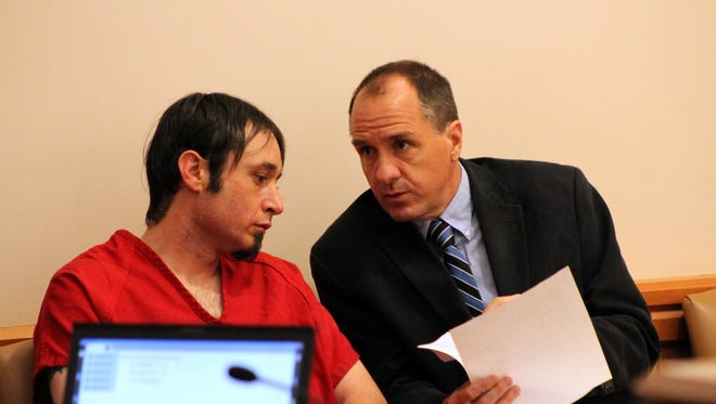 Christopher David Parker appears in court in March with his public defender Eric Vanatta for his first hearing after being accused in the fatal shooting of Loveland resident William Connole in 2015 and another shooting at a motorcyclist that did not result in injuries.