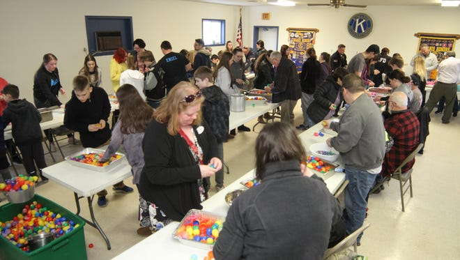 South Lyon Kiwanis Club members and other volunteers getting ready for the annual Easter Egg Hunt.