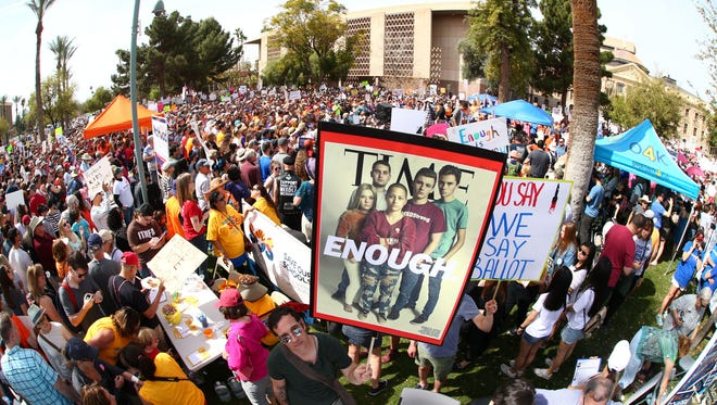 """March For Our Lives protesters demand """"their lives and safety become a priority and that we end gun violence and mass shootings in our schools and communities"""" march at the Arizona State Capitol on Mar. 24, 2018 in Phoenix, Arizona."""