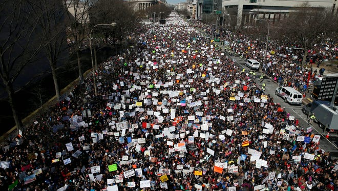 "Looking west, people fill Pennsylvania Avenue during the ""March for Our Lives"" rally in support of gun control, on March 24, 2018, in Washington."