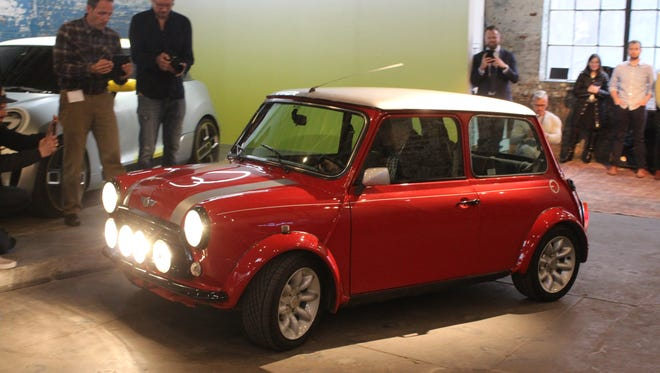 An electric version of a 1960s Mini makes an appearance at an event for the brand ahead of the New York Auto Show. It is meant to show the brand's electric future, although it won't be produced.